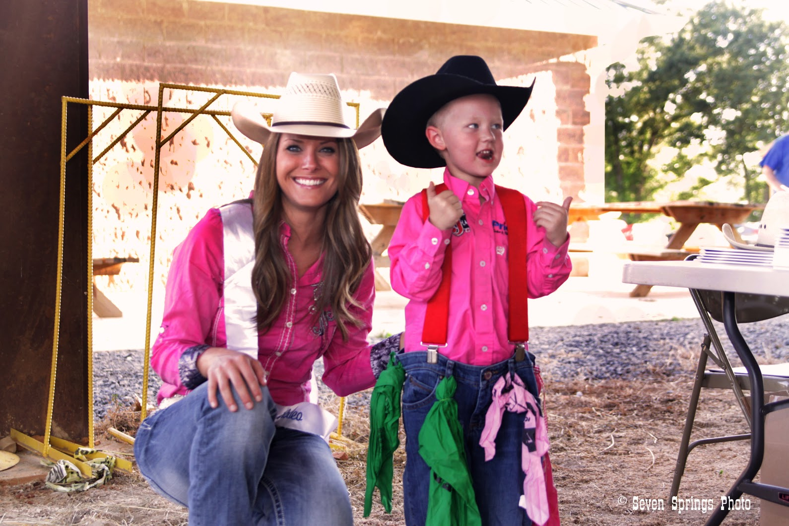 Miss Rodeo with child fan